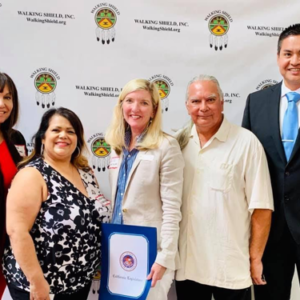 Representative Liz McNabb (center) expresses the unwavering support of Assemblywoman Cottie Petrie-Norris. From left to right, Workforce Director Rene Williams (Colville), Walking Shield Program Director Lynda Estrella Gonzales (Yaqui), McNabb, Walking Shield Executive Director Dr. John Castillo (Apache), and UAII Director of Development Joseph Quintana (Kewa Pueblo).